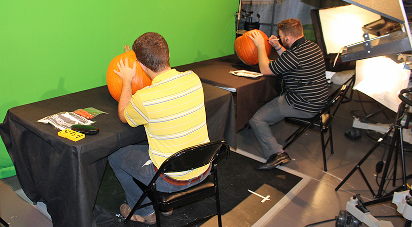 D.J. Piehowski and Marc Lepecheur from PGATOUR.COM work on this year's Halloween pumpkins.